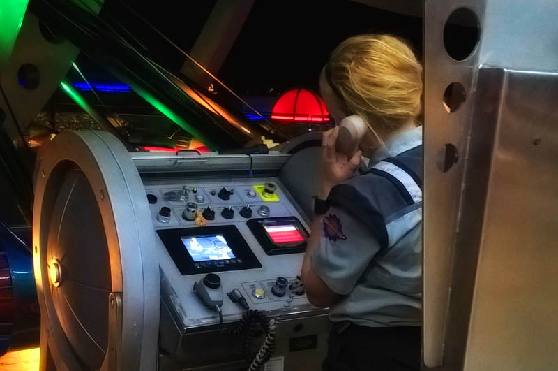 This poor cast member tried hard to get Astro Orbiter flying again, but there was no time for us to wait.